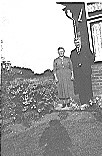 Grampy and Granny Garner in front garden - Hawkins Web Site